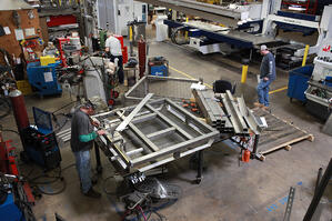 Marlin Steel employees hard a work building custom metal forms for customers.