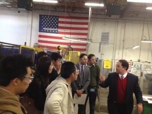 Marlin Steel President Drew Greenblatt gives plant tour to graduate students from Johns Hopkins University Carey Business School