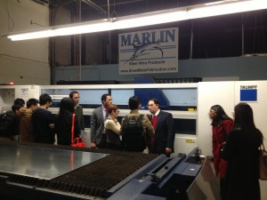 Marlin Steel President Drew Greenblatt describes the automation of sheet metal cutting to master's degree students from Johns Hopkins University Carey Business School
