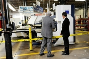 Dr. Greenblatt shows Treasury Secretary Geithner Marlin's new Laser Cutter