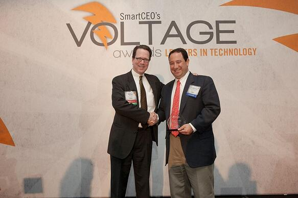 Marlin Steel President Drew Greenblatt accepts a Baltimore VOLTAGE Award for 2013