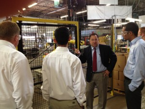 Describing the robots in safety cages to visitors at Marlin Steel