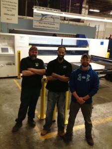 Three Marlin Steel employees in front of Marlin Steel's Trumpf laser
