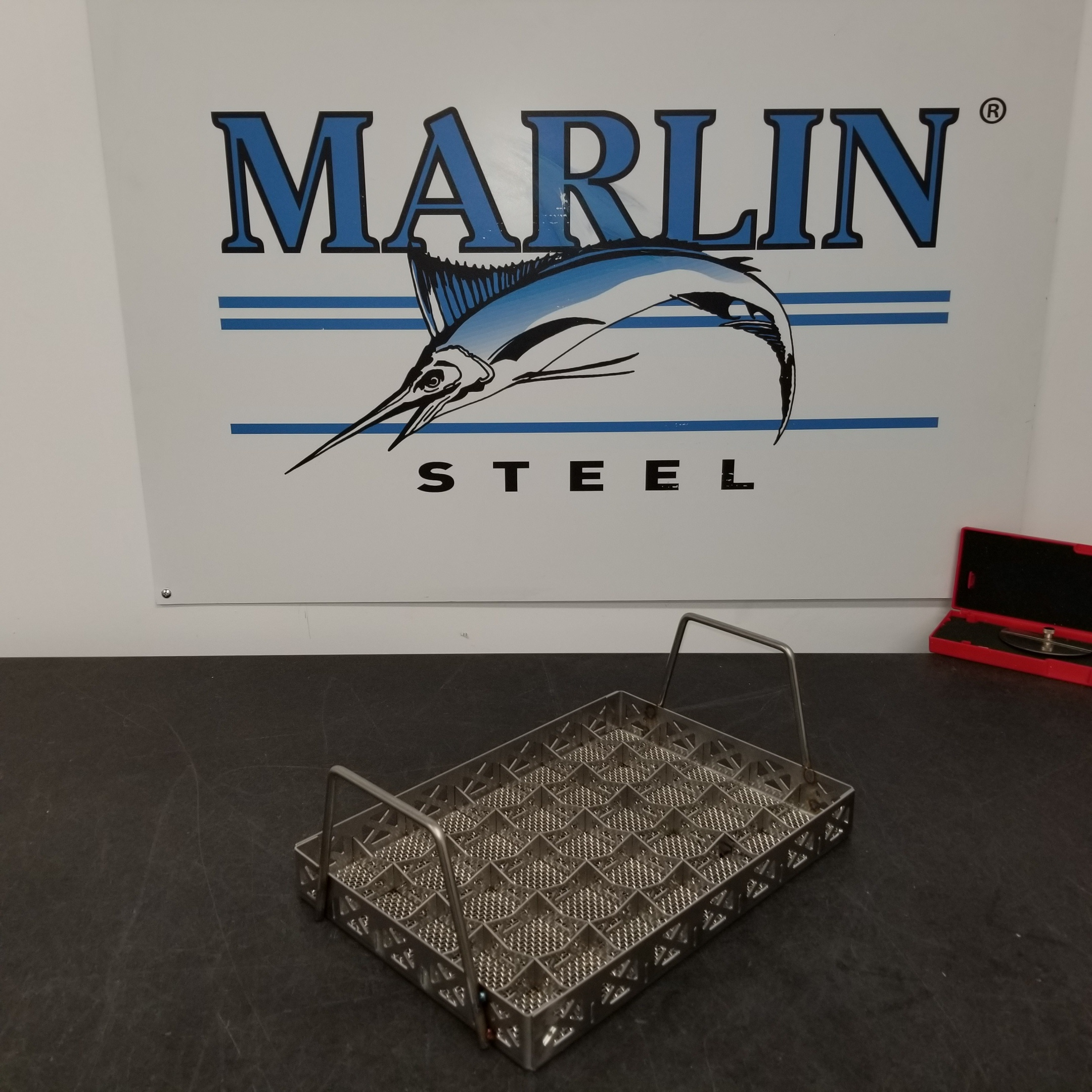 This custom wire basket uses handles and dividers to create something that's easy to handle and keeps parts safe.