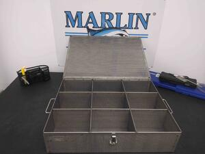 This perforated sheet metal basket was given dividers and a lid to help optimize it for small aircraft parts.