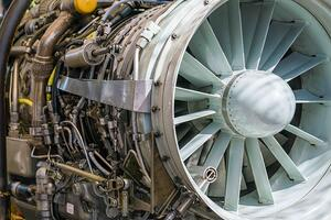 Exposed aircraft engine that has stainless steel and other metal alloys.