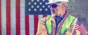 American_worker_in_hard_hat_with_flag
