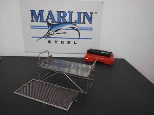This is one of several automotive baskets that was made to accommodate the client's wide variety of parts. The slotted sheet metal portion would hold parts vertically during the wash, while the mesh lid would keep parts from sliding out.