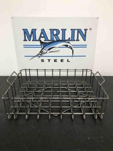 A Marlin Steel hydraulic cylinder basket with handles.