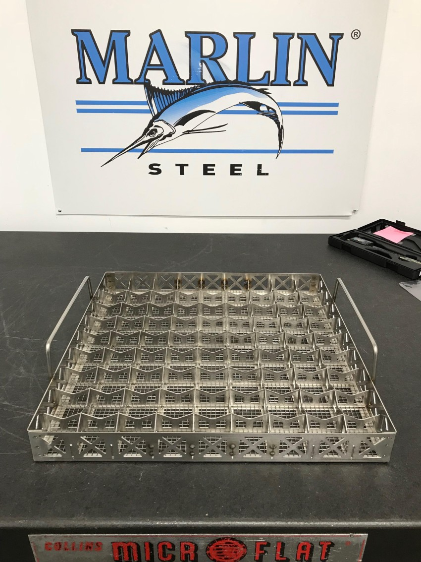 This custom parts washing basket uses numerous sheet metal dividers to keep delicate parts separated in harsh washing processes.