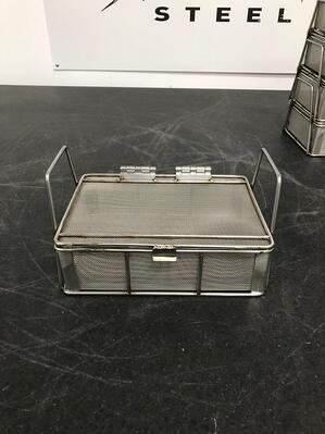 This stainless steel mesh basket has large handles for easy carrying and a tight lid to keep parts in the basket.