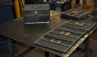 Wire Mesh Basket Components Laying on Workbench After Welding