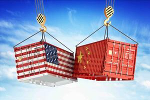 Two shipping containers in the colors of the American and Chinese flags crashing together.
