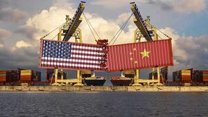 Shipping containers with US and Chinese flags colliding in a shipping port.