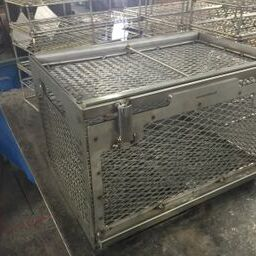 The expanded mesh enclosure protects parts in a maximum-strength steel cage.