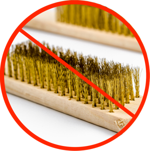Just say no to using metal scrub brushes on food-grade stainless steel.