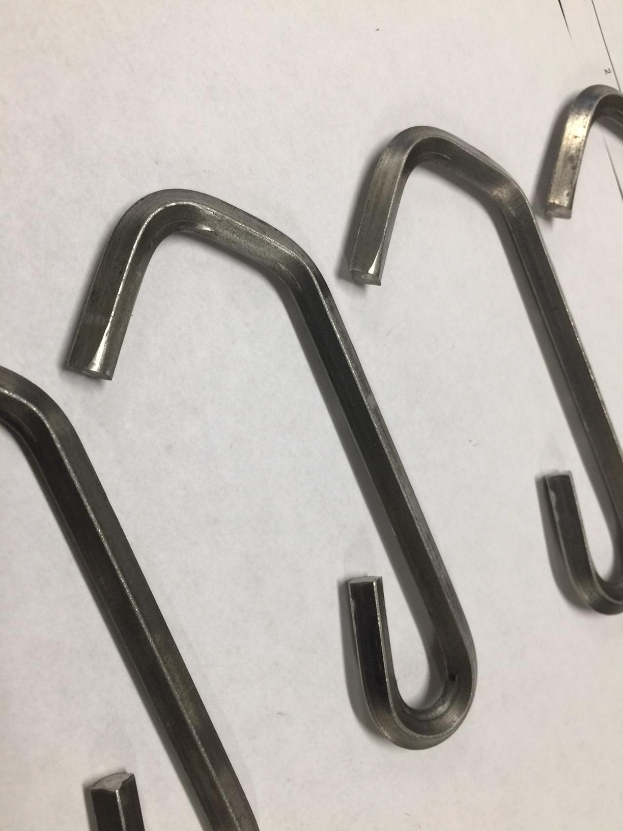 Keeping the edges on an inside bend sharp is one of the biggest challenges for diamond wire hooks.