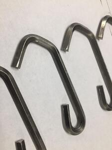 Diamond wire hooks can be a bit more difficult to shape than rounded wires because the angle of the wire as it passes through a machine matters more.