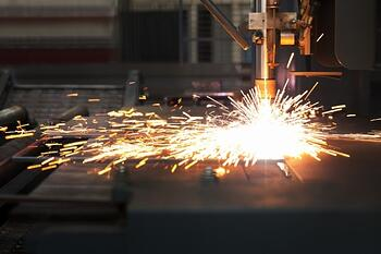 Industrial CNC Plasma Cutter Cutting a Piece of Steel
