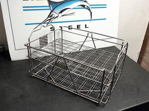 This custom wire basket uses offset wires to hold aerospace parts in place during wash cycles.