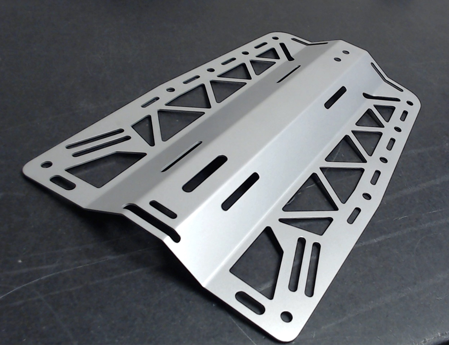 Custom sheet metal fabrications can come in all shapes and sizes--not just baskets and trays, but other components too.