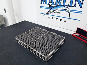 Stainless steel baskets like this one often go through many design revisions using different types of stainless steel.